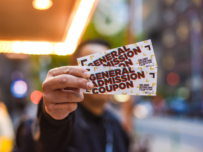 A person holding passes to the Calgary International Film Festival