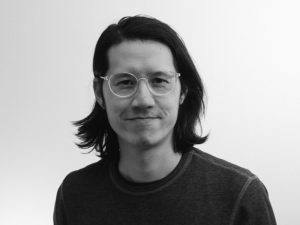 A black and white photo of Emmanuel Ho
