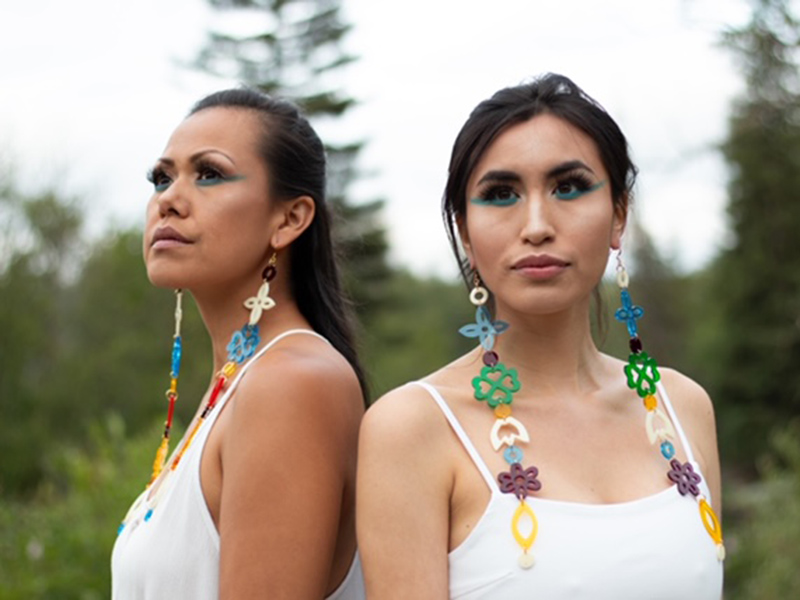 Two Indigenous women wearing beautiful earrings