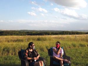Glenna Cardinal and Seth Cardinal Dodginghorse in a field
