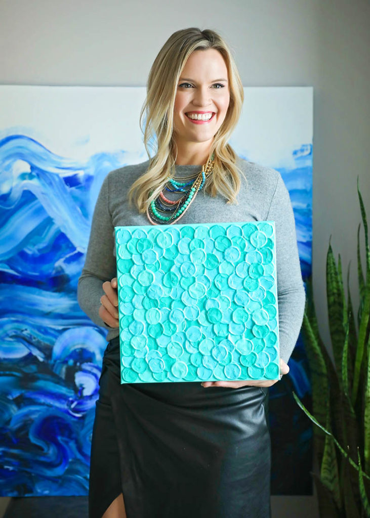 Alex Hunt holding her Tiffany Blue painting