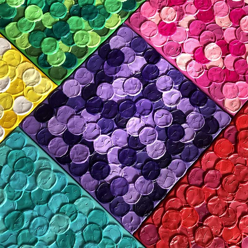 Miniature canvases of bright coloured paint dots by Alex Hunt