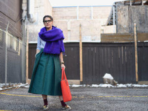 A photo of Kayla Browne dressed in bright and stylish colours
