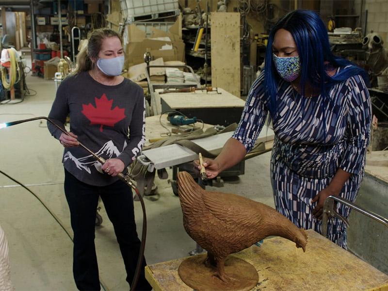 Karen Begg and Adora Nwofor in the Studio West Bronze Foundry, working on a bronze chicken statue