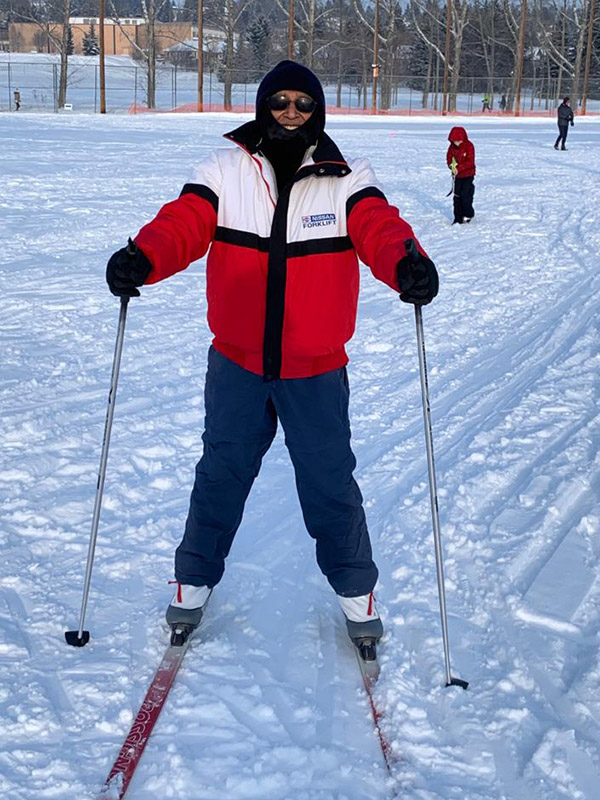 Lalit Jain smiling while cross country skiing in Calgary