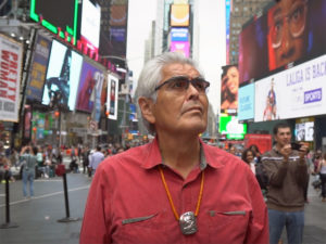 A still from Haida Modern if an Indigenous man in Times Square
