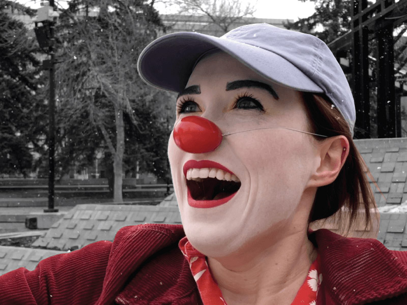 A photo of a clown in Olympic Plaza
