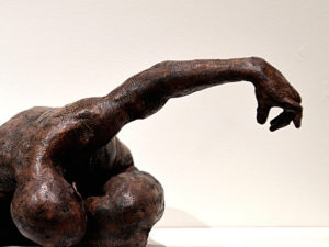 A sculpture of an arm in What A Difference A Day Makes
