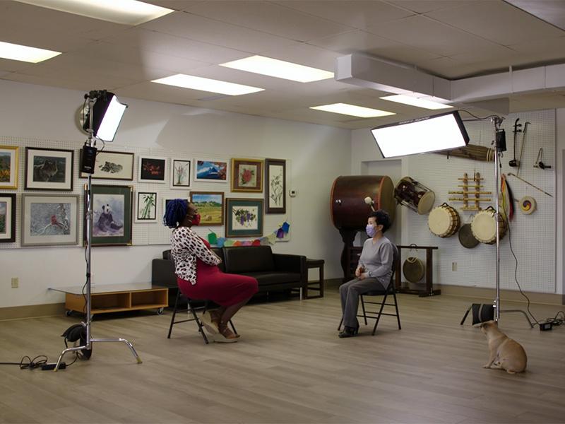 Adora Nwofor and Anna Ko set up for an interview at the Korean Art Club