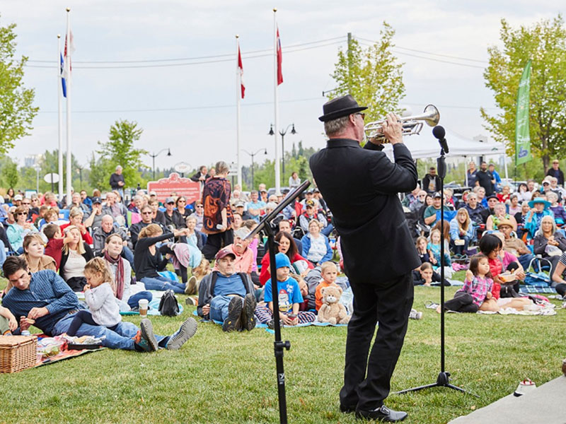 A musician plays for a pre-COVID crowd at Heritage Park