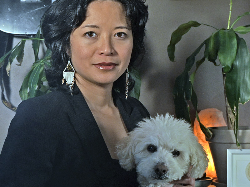 A photo of jaqs gallos aquines and a small white dog named Bowie
