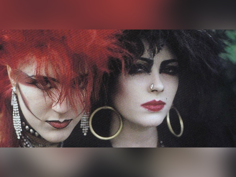 An image of two Goth women