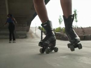 A still of Ador Nwofor and Livvy Skates rollerskating