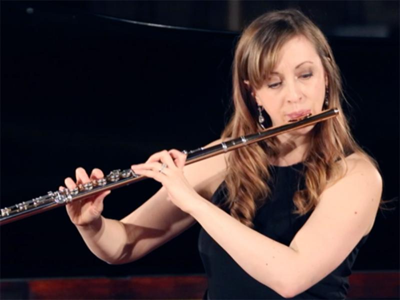 A photo of Sarah McDonald playing the flute