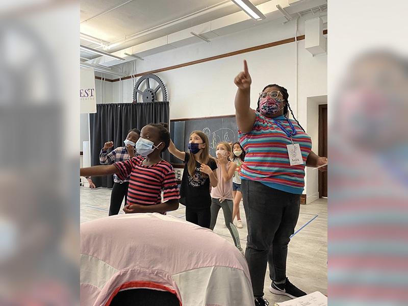 Keshia leads Quest Theatre campers through a scene