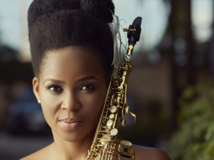 A promo photo of Perpetual Atife with her saxophone